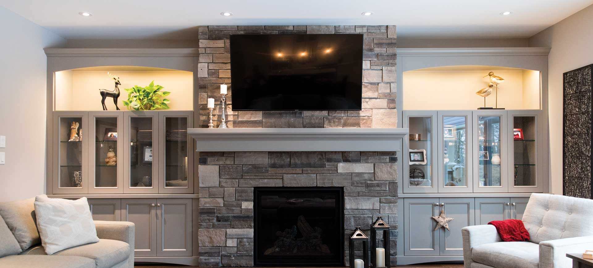 taupe fireplace mantle and cabinets