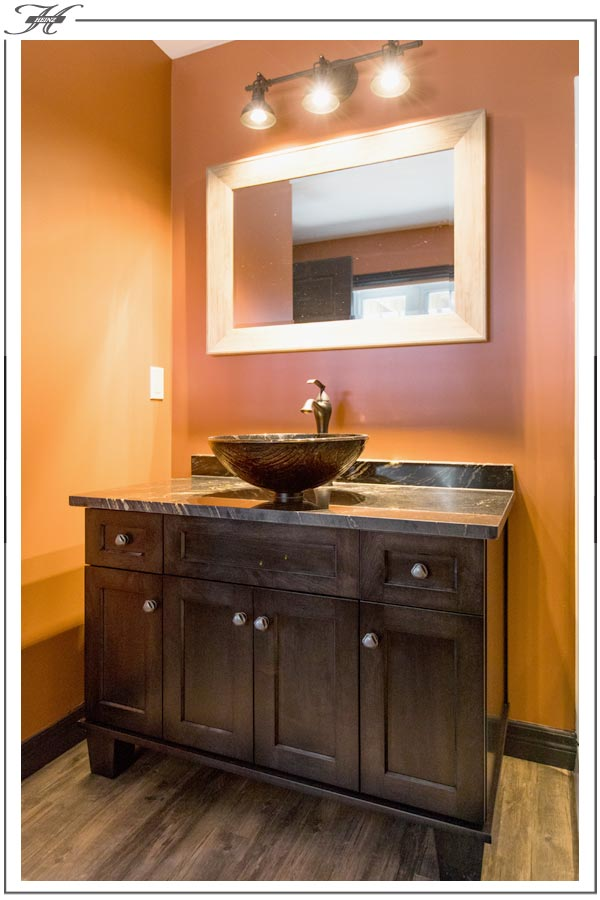 dark wood vanity with above counter water basin