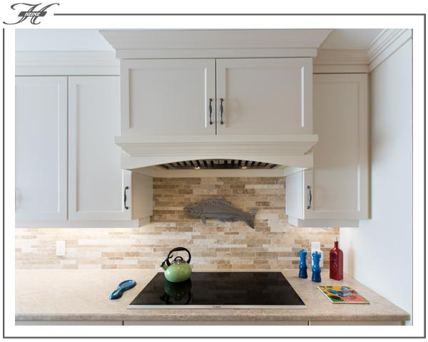 white cabinet hidden stove-hood cover