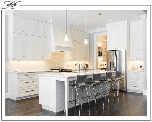 All white kitchen cabinets and countertops with island