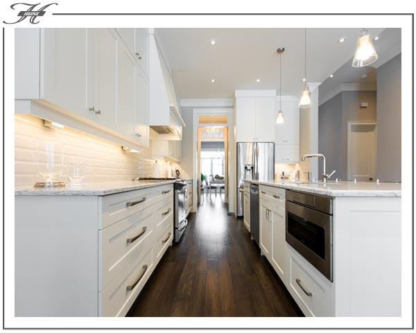 white cabinet drawers with marble countertops